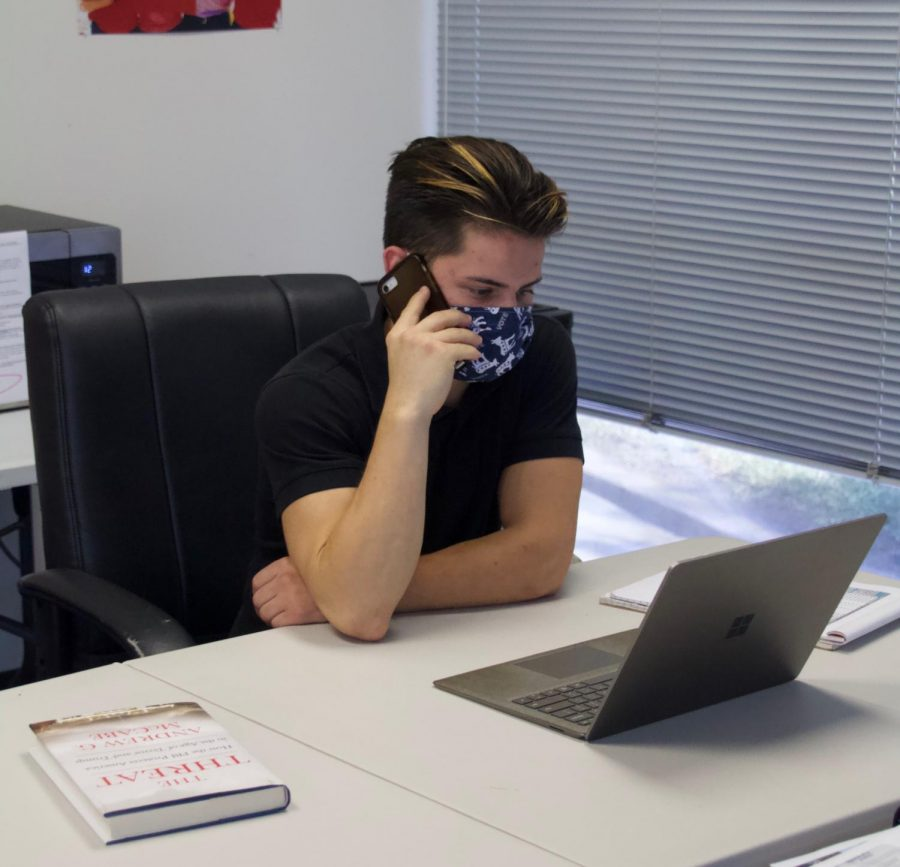 Deputy Field Director and Intern Supervisor Gehrig Urbano makes phone calls to voters to inform them of safe ways to return their vote by mail ballots.