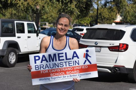 Pamela Braunstein poses with her campaign sign at a campaign event in Ladera Ranch this past weekend. She is running to represent Trustee Area Two on the CUSD Board of Trustees, which includes Ladera Ranch, Rancho Mission Viejo, Coto de Caza, Las Flores, and parts of San Juan Capistrano. The seat is currently held by Trustee president, Jim Reardon, but Braunstein is hopeful that she can win.