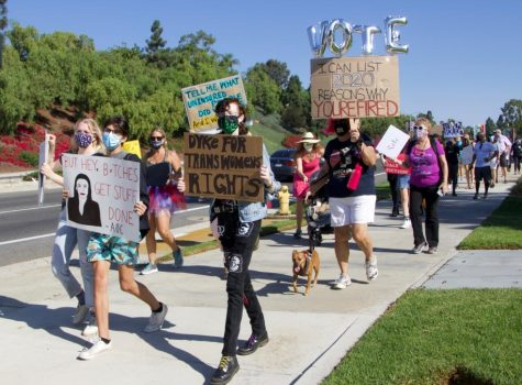Students and families carry signs at a Women's March that took place on Saturday, October 18th. It was organized and hosted by the student youth organization CUSD Against Racism to protest Amy Coney Barrett's nomination as a Supreme Court Justice.