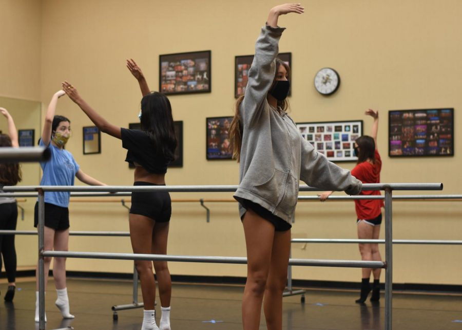 Students in the dance program warm up at the beginning of class. In order to comply with CDC guidelines, the dancers remained six feet apart from one another.