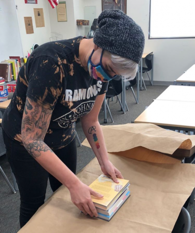 English teacher and queer alliance advisor creates the LGBTQ+ care packages with several titles surrounding different aspects of queer experiences.