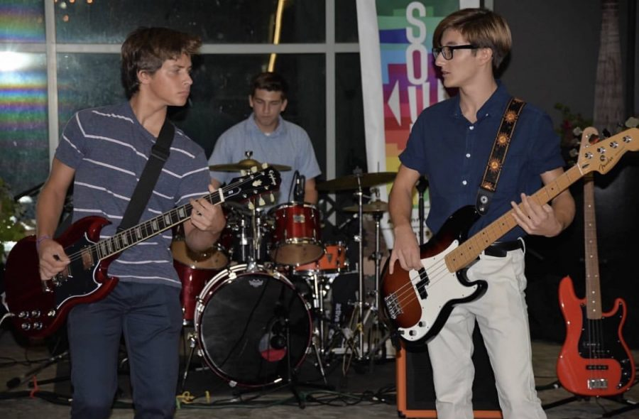 """Adam Vuoso, a sophomore at SJHHS, performing with """"Color of Sound"""" at the Kaleidoscope as lead guitarist."""