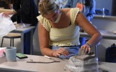 A student in the pottery elective works on her clay project. The student wears a face mask to follow CUSD's safety precautions upon the return of schools during COVID-19.