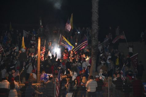 "Thousands of protestors across the state of California attended ""Curfew Breakers"" rallies in response to the 10 pm curfew announced by Governor Gavin Newsom. Protestors at this event near the San Clemente burned masks, signaling not only a frustration with public health regulations, but also a denial of the seriousness of the worsening pandemic."