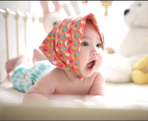 This image shows a happy baby in their crib. Kids, as well as parents, would do well by having a parent at home with them. Especially during the pandemic, where daycares and schools are closed, a parent home would help with their development.