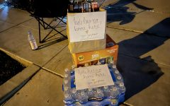 The Si family is the latest victim in Ladera Ranch to severe anti-Asian harassment. Neighbors are uniting together to prevent these attacks by waiting in shifts outside of the targeted house. Members of the community often bring food for the volunteers. Pictured is a brown bag of food and case of bottled water with a label in front saying