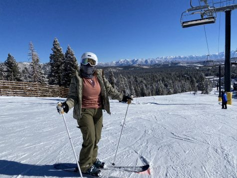 Colleen Aitken (10) is shown skiing on Mammoth Mountain with a facial covering to follow new COVID-19 guidelines for the 2020-2021 ski season.