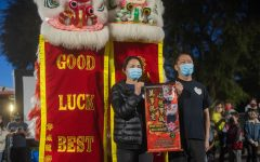 This lantern festival was hosted to share Chinese culture and raise awareness towards anti-Asian attacks in the community. The Si family has been the latest victim of anti-Asian harassment, where teenagers threw rocks at their house and yelled racist slurs at them. Haijun Si and his wife stand in front of banners saying Good luck best wishes.