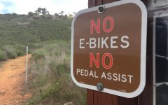 The rise in e-bikes has prompted some trails to deny trail access. Signs like these have been posted at trail heads warning e-bikes from riding yet still allowing traditional bikes access to the area.