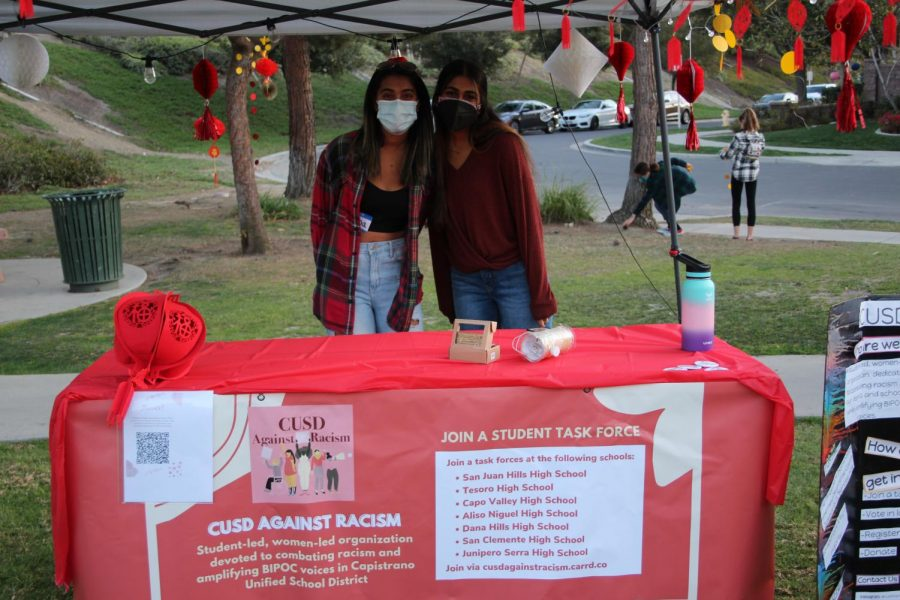 Task force leaders of San Juan Hills Against Racism, an organization dedicated to minimizing racism on campus, Sarina Iyer (12) and Sandhya Ganaesan (11) answered questions and helped guests at the CUSD Against Racism booth. CUSD Against Racism helped host the festival.