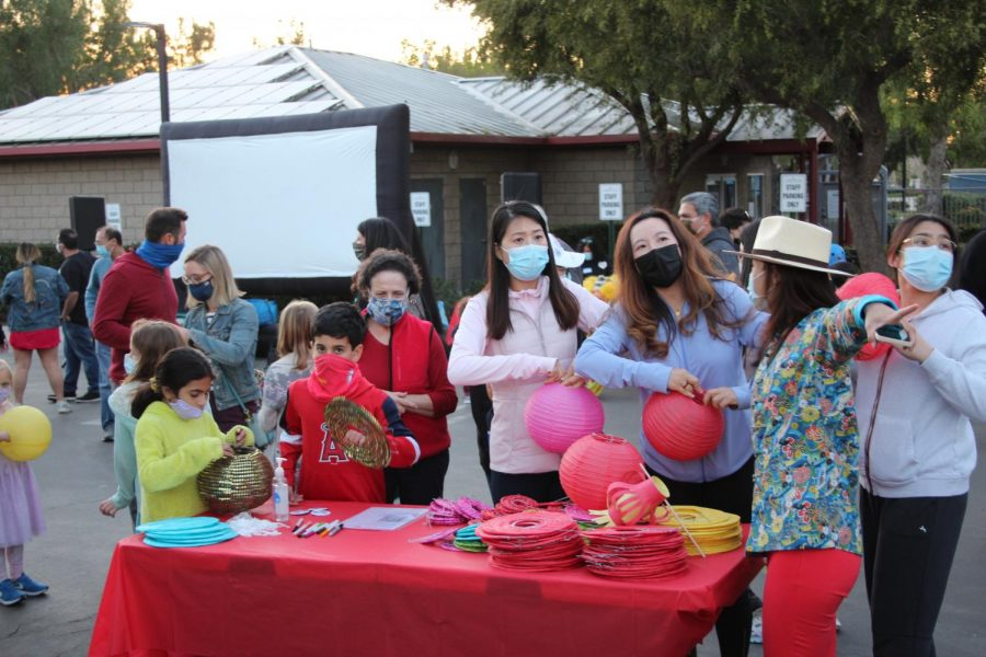 Attendees of the festival prepare their lanterns. At the event, all guests were masked to follow COVID-19 guidelines.
