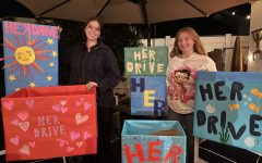Organizers Bethany Padilla and Reaghan Mulligan pose with the donation boxes they decorated. The boxes were put around Capistrano Unified School District high schools and in front of Kathys House.