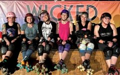 The High Tide Roller Derby team, with members Danielle Flint, Kaitlin Naccarato, Chelsea Skoien, and Thara Foster poses for a photo at one of their events.