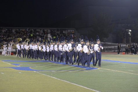 The marching band walks on the field to play the national anthem for the homecoming game. They play at every game and will preform the half time show again at the Mission Viejo game on October 22.
