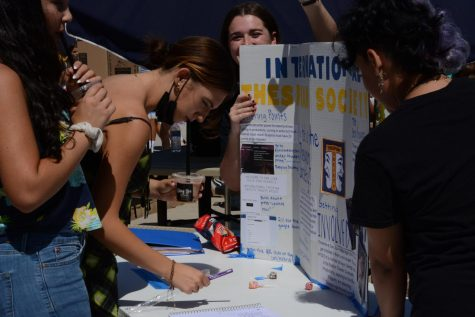 Thespian Club Sign-Up: A student signs up for the International Thespian Society (ITS), a club dedicated to the theatre program. Clubs such as the ITS appeal to students who want to have further involvement in school activities through community work and group organizations.