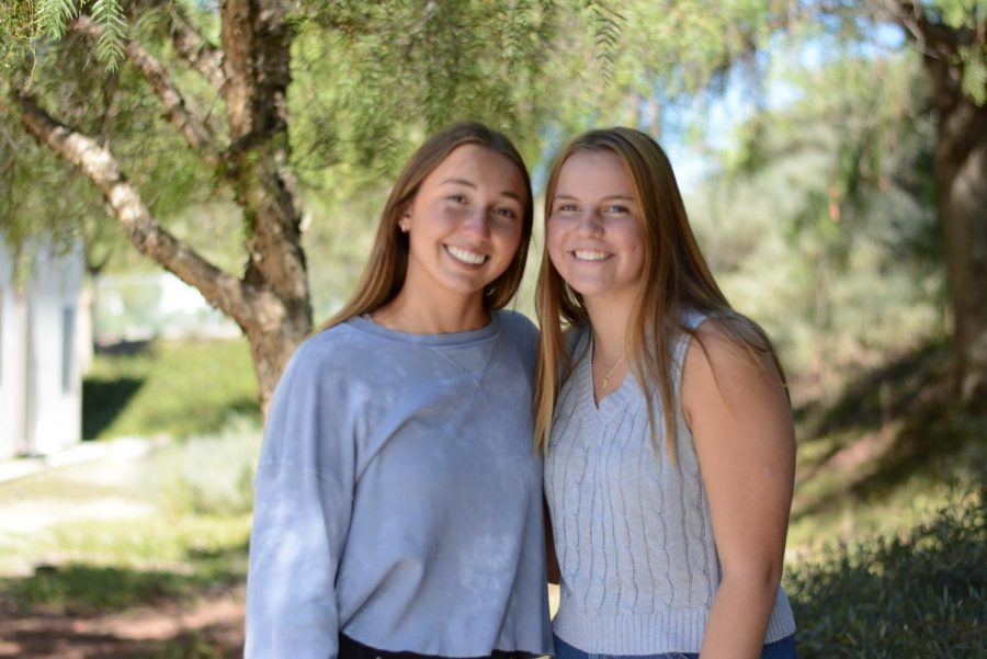 Cari Brandt (12), Young Democrats co-president and Reagan Hirchag (11), Young Republicans president, stand together despite differing political views.