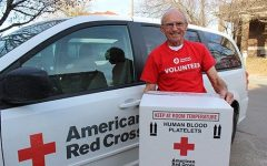 A Red Cross Member holds box of donations for hospital delivery. Each drive marks a positive turning point for many patients in need, and the October 26th drive with CUSD is no exception to that goal.